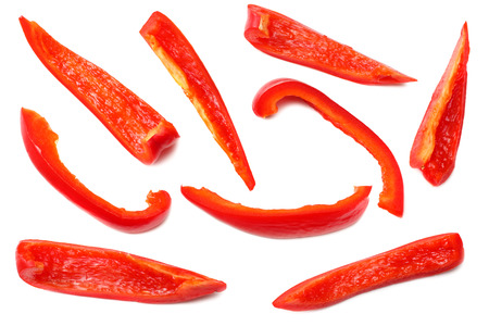 cut slices of red sweet bell pepper isolated on white background top view