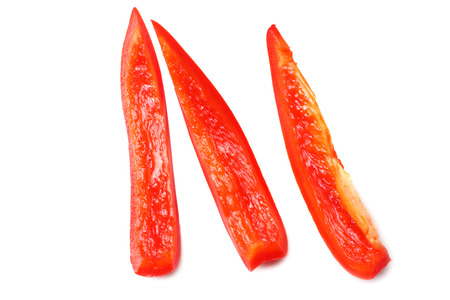 cut slices of red sweet bell pepper isolated on white background top view Banque d'images - 120830401