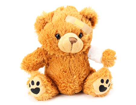 toy teddy bear with bandage isolated on white background Stock fotó