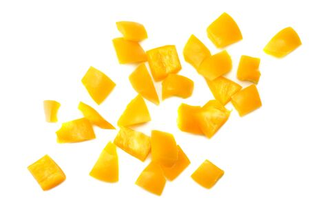 cut slices of yellow sweet bell pepper isolated on white background top view