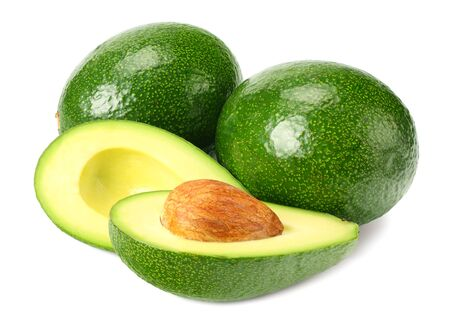 healthy food. fresh avocado with slices isolated a on white background Фото со стока