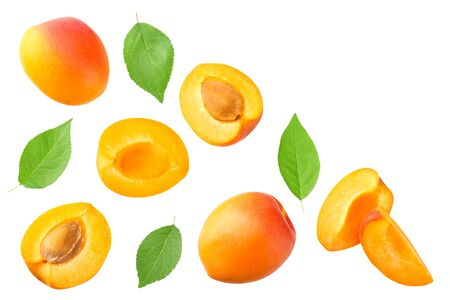 apricot fruits with slices and green leaf isolated on white background. top view 免版税图像