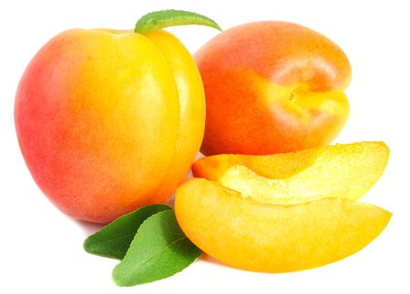 apricot fruits with slices and green leaf isolated on white background