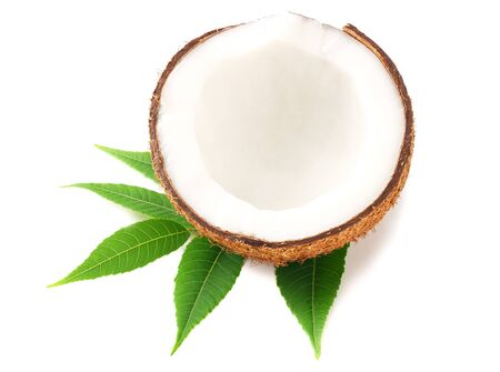 half of coconut with green leaves isolated on white background Stock Photo
