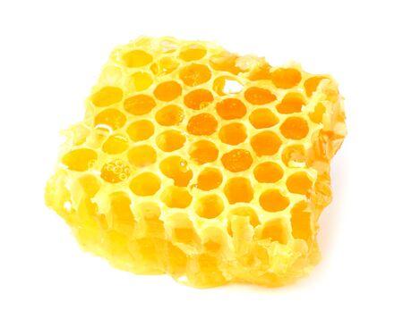 Wabe mit Honig lokalisiert auf weißem Hintergrund Standard-Bild