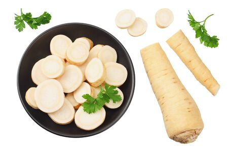 fresh parsley root with slices and parsley in a black plate isolated on white background. top view