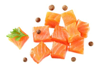 Red fish. Raw salmon fillet with parsley and peppercorns isolate on white background. Top view