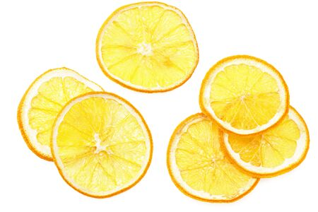 dried slices of orange isolated on a white background. top view
