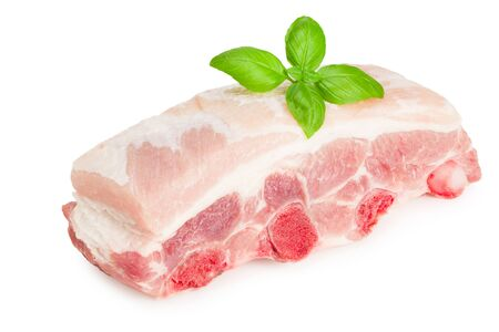Raw pork ribs with basil isolated on white background