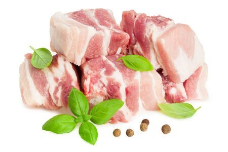 Raw pork ribs with basil and peppercorns isolated on white background Imagens