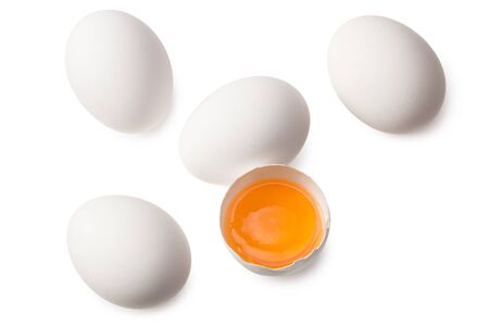 Chicken egg is half broken among other eggs isolated on white background. Top view