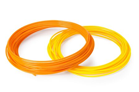 Orange and yellow filament 3d printer isolated on white background Imagens