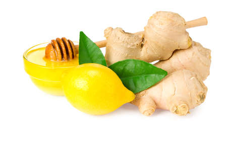 ginger roots with slices, green leaves, lemons and honey isolated on white background