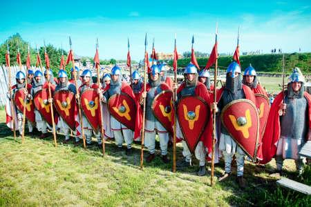 troop: troop of medieval knights in full armor Editorial