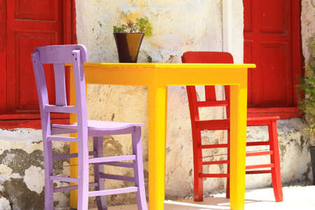 colorful street cafe table and chairs