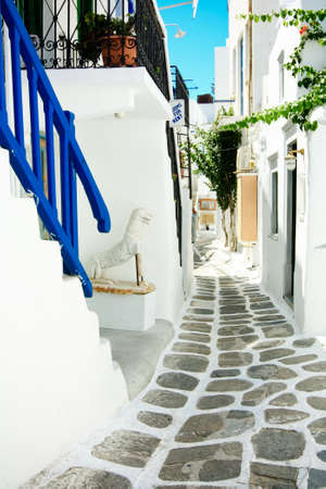 whitewashed: narrow street in Mykonos with white-washed houses