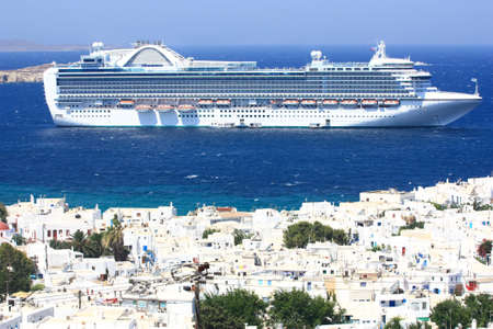 huge cruise ship at anchor in Mykonos island, Greece