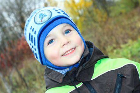 three year old: cute little boy with bright blue eyes smiling Stock Photo