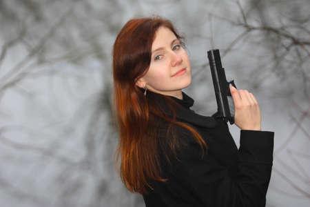 pretty woman holding a gun photo