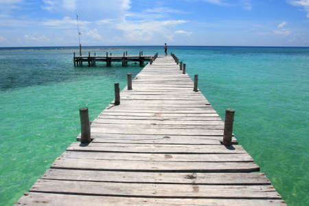 wooden pier in the Caribbean and turquoise water