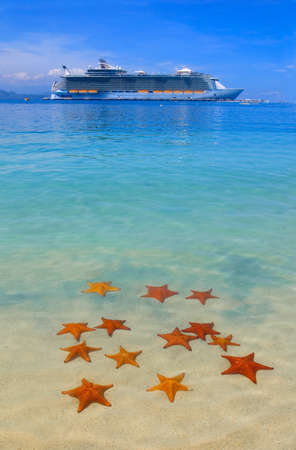cruise: cruise ship in the Caribbean paradise and starfish on the beach Stock Photo