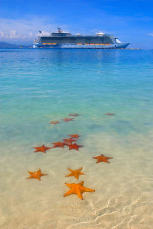 cruise ship in the Caribbean paradise and starfish on the beach photo