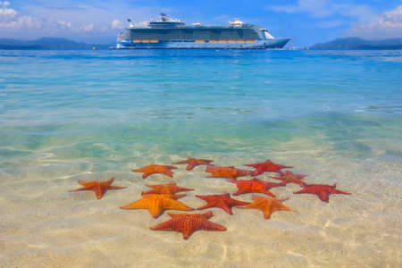 cruise ship in the Caribbean paradise and starfish on the beach Stock Photo