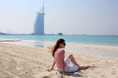 al: young woman at the beach next to Burj Al Arab Hotel in Dubai
