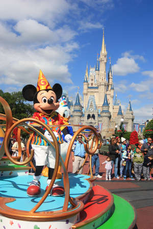 Magic Kingdom castle in Disney World in Orlando and Mickey Mouse