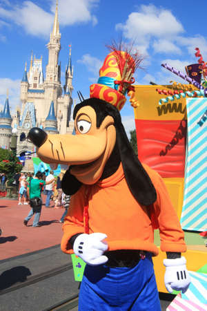 Magic Kingdom castle in Disney World in Orlando and Goofy