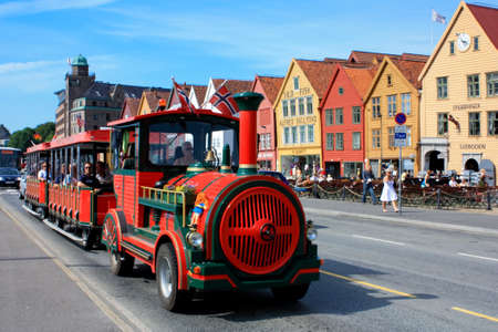 Bryggen district and sightseeing train in Bergen, Norway