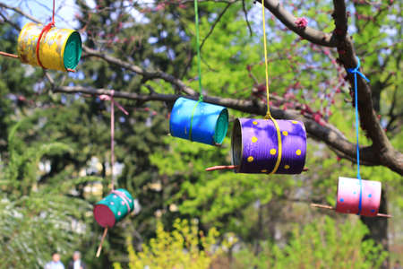 feeders: colorful bird feeders made of tins and cans