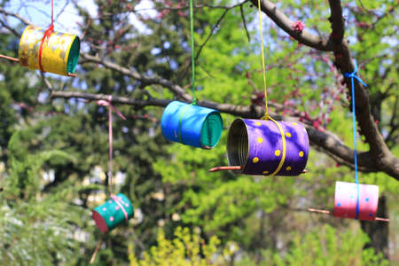 tins: colorful bird feeders made of cans and tins