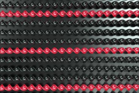 Black and red plastic spiral sticks on black background. Abstract background. 3D render illustration