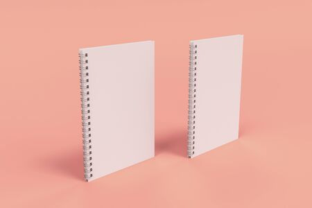 Two blank notebooks with white cover and metal spiral bound on red background. Business or education mockup. 3D rendering illustration