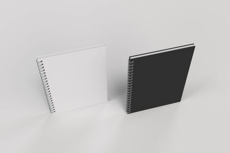 two: Two blank notebooks with black and white covers and metal spiral bound on white background. Business or education mockup. 3D rendering illustration