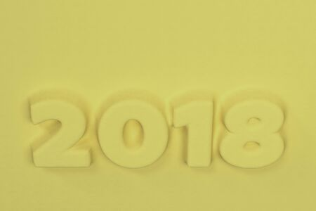 Yellow 2018 number bas-relief. 2018 new year sign. 3D rendering illustration Stock Photo