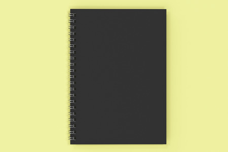 Closed blank notebook with black cover and metal spiral bound on yellow background. Business or education mockup. 3D rendering illustration