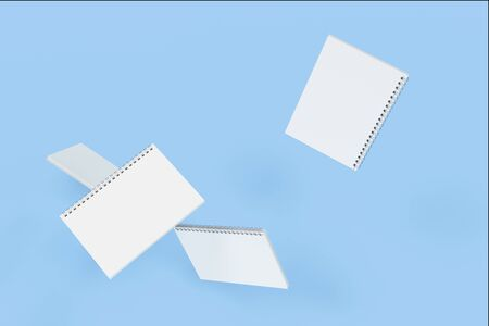 Four blank notebooks with white covers and metal spiral bound on blue background. Business or education mockup. 3D rendering illustration