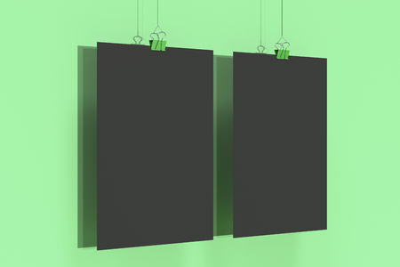 Two blank black posters with binder clip mockup on green background. Poster or paper sheet template. 3D rendering illustration
