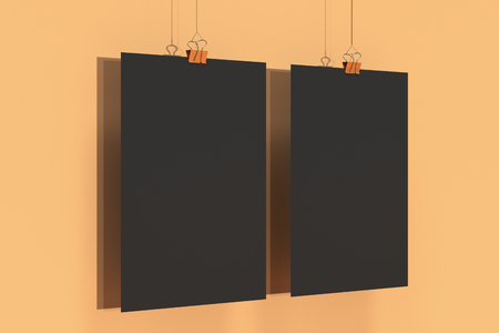 Two blank black posters with binder clip mockup on orange background. Poster or paper sheet template. 3D rendering illustration Stock Photo
