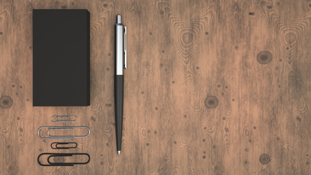 Black business cards, paper clips and automatic ballpoint pen on wooden table. Blank paper mockup. 3D rendering illustration.