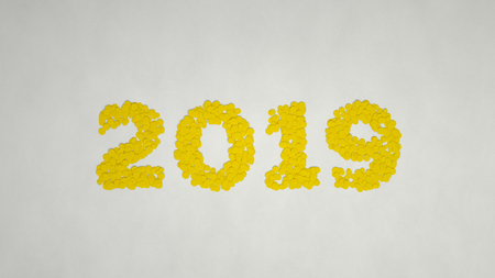 2019 number made from yellow confetti on white background. 2019 new year sign. 3D rendering illustration