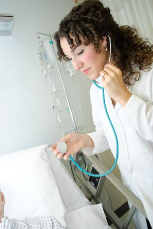 stethoscope: Young medical student using a stethoscope Stock Photo