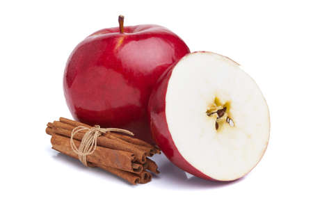 Apples and cinnamon on white background photo