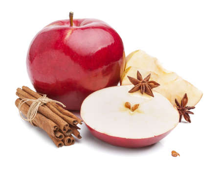 Apples with cinnamon and anise stars on white background photo