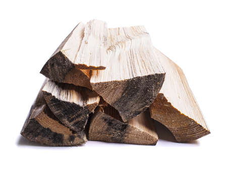 Pile of firewood isolated on a white background photo