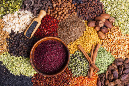 Colorful spices and herbs background