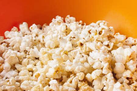 bowls of popcorn: popcorn in bright plastic bowl