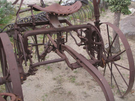 rusty farm implement in the desert